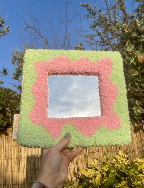 Small tufted mirror