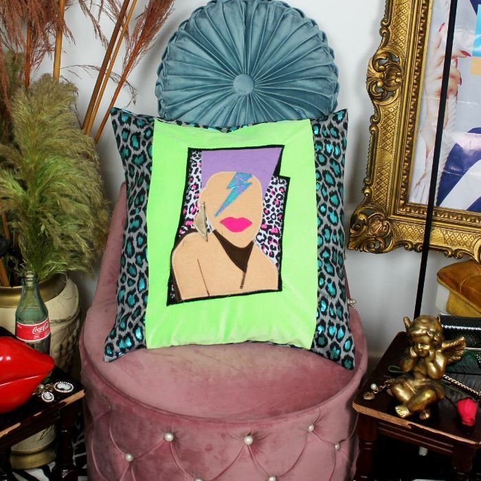 Leroy Stardust handmade decorative throw cushion in neon green velvet and blue leopard print with 80's face applique